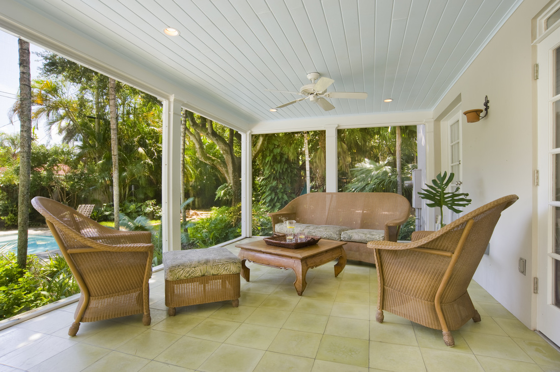 the outdoor room features screening casual furniture to create a comfortable space year round - The Outdoor Room